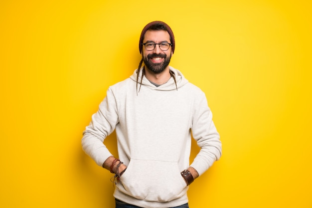Hippie man with dreadlocks smiling with a sweet expression Premium Photo