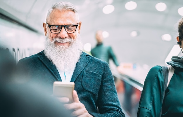 Hipster bearded man using mobile smart phone at shopping mall elevators Premium Photo