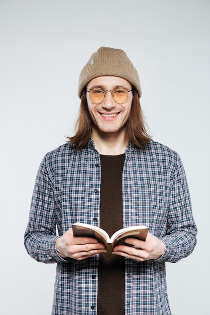 Hipster in eyeglasses with book | Free Photo