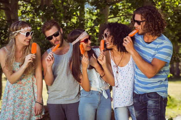 Hipster friends enjoying ice lollies Premium Photo