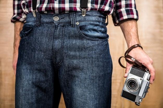 Hipster man holding digital camera Premium Photo