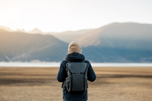 Hipster man traveler with sweater and backpack traveling at napa lake Premium Photo