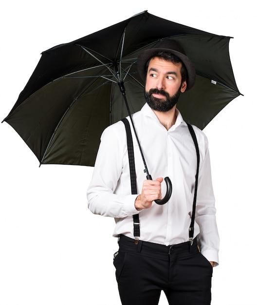 Hipster Man With Beard Holding An Umbrella Photo