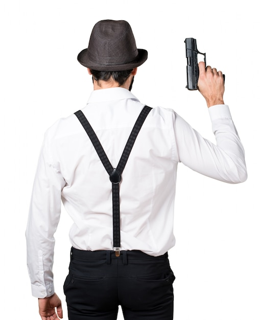 Hipster man with beard with a pistol Free Photo