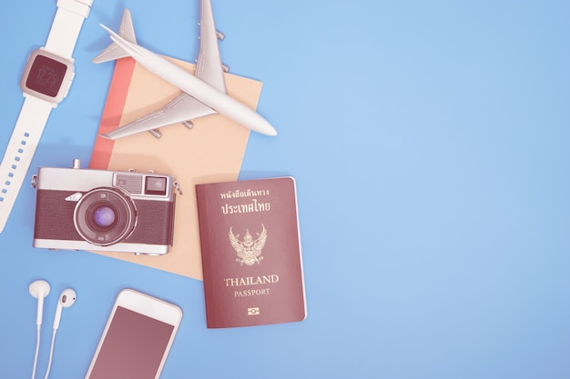 Hipster modern travel object on blue copy space for travel concept Premium Photo