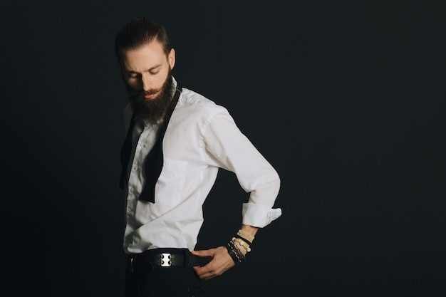 Hipster style bearded man white shirt in studio over black background Free Photo