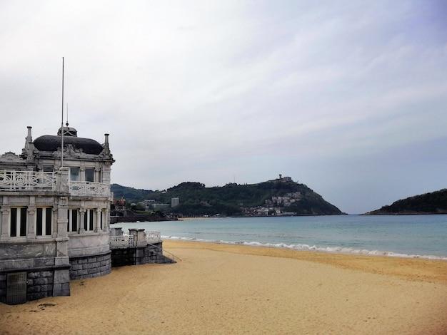 Historic ancient building at the seaside in san sebastian resort town, spain Free Photo