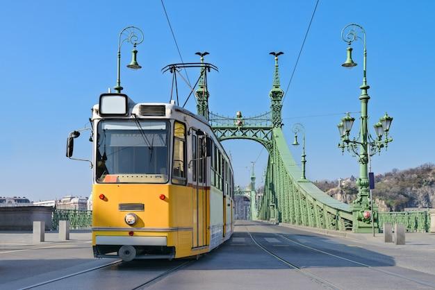 Historic tram on freedom bridge in budapest Premium Photo