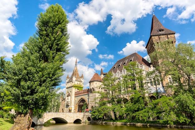 Historical building in budapest vajdahunyad castle over the blue sky in main city park varosliget Premium Photo