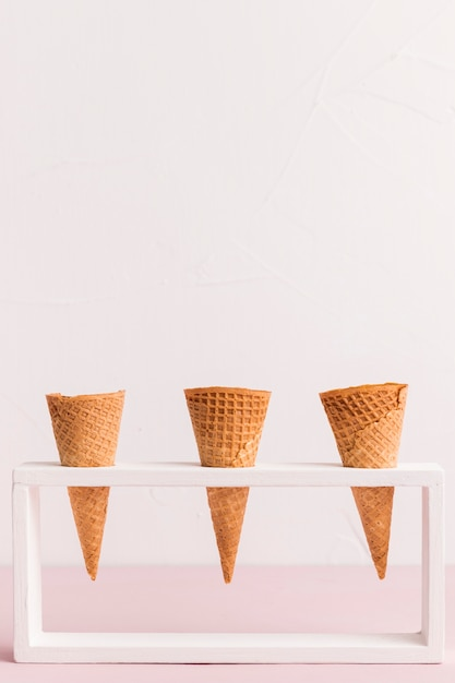 Holder with conical ice cream cornets Free Photo