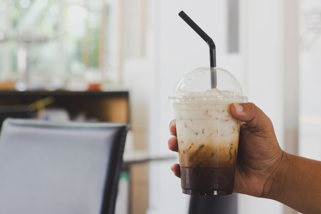 Holding coffee in a coffee shop Premium Photo