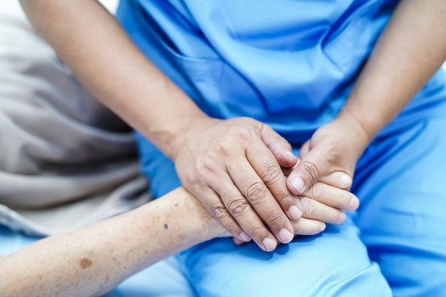 Holding hand asian senior or elderly old lady patient with love, care, encourage and empat Premium Photo