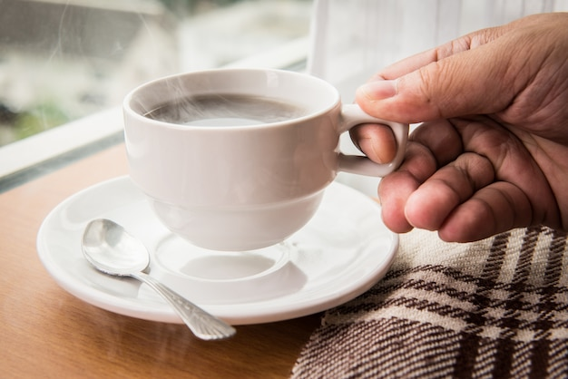 Holding hot cup of coffee Premium Photo