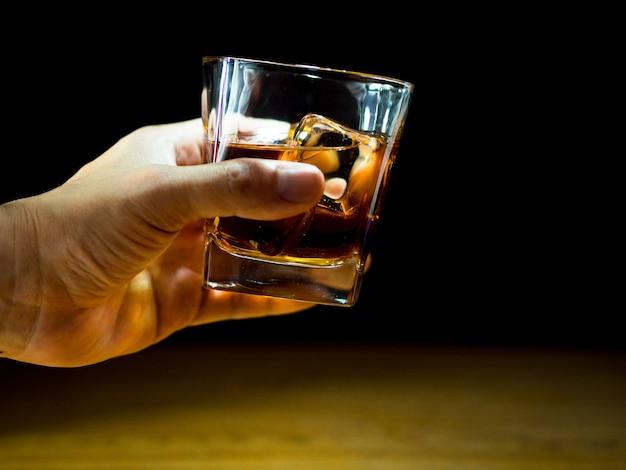 Holding whiskey Premium Photo