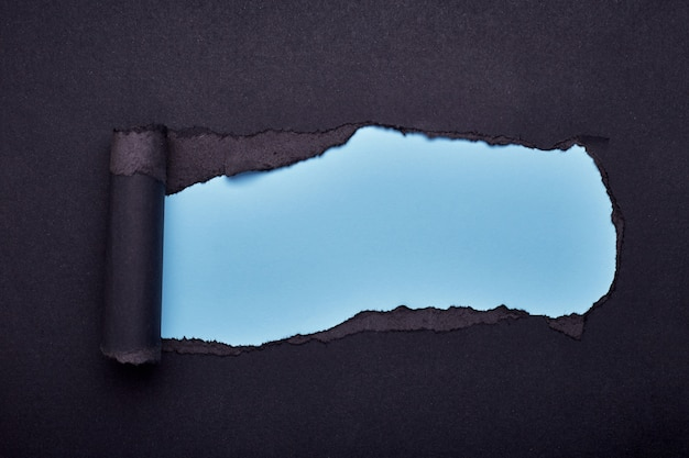 Hole in the black paper. torn. wooden . abstract . Premium Photo
