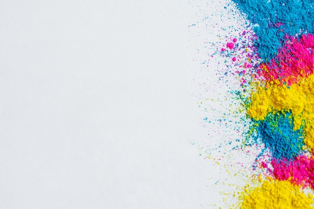 Holi color background on white background Free Photo