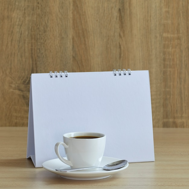 Holiday concept coffee and empty calendar Premium Photo