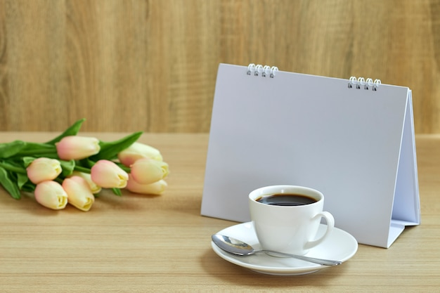 Holiday concept coffee and empty calendar Premium Photo