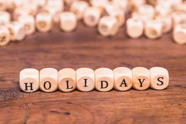 Holidays word made with wooden cubes Free Photo