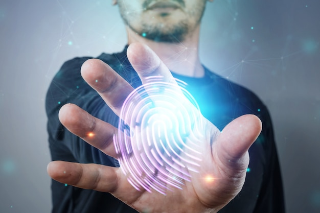 Hologram fingerprint, male hand information technology cyber security Premium Photo