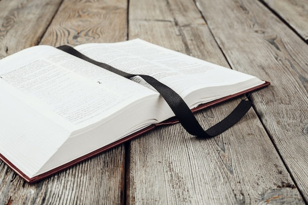 The holy bible on a wooden table Premium Photo
