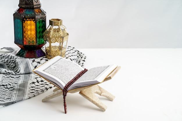 Holy quran and arabic lantern on white Premium Photo