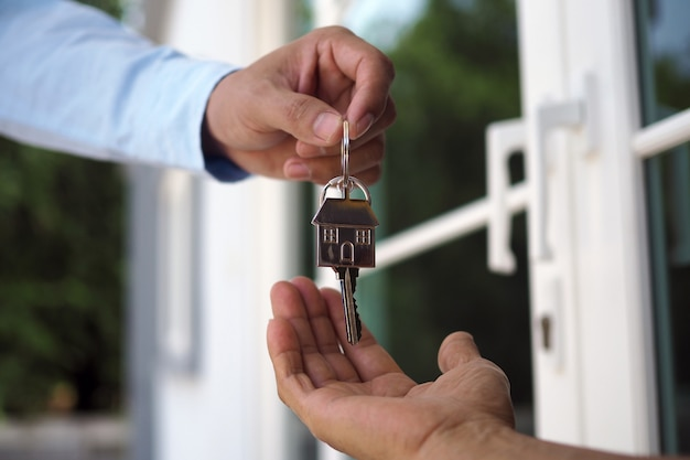 Home buyers are taking home keys from sellers. sell your house, rent house and buy ideas. Premium Photo