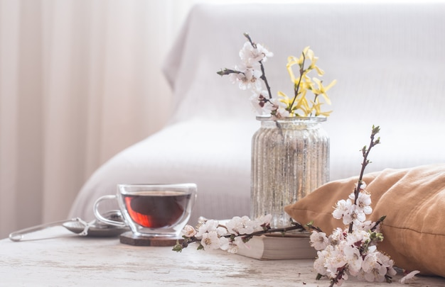 Home decor in living room cup of tea with spring flowers Free Photo