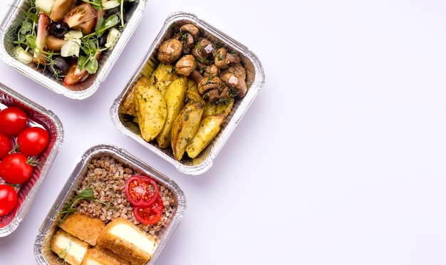 Home delivery concept. food in containers. potatoes with mushrooms. Premium Photo