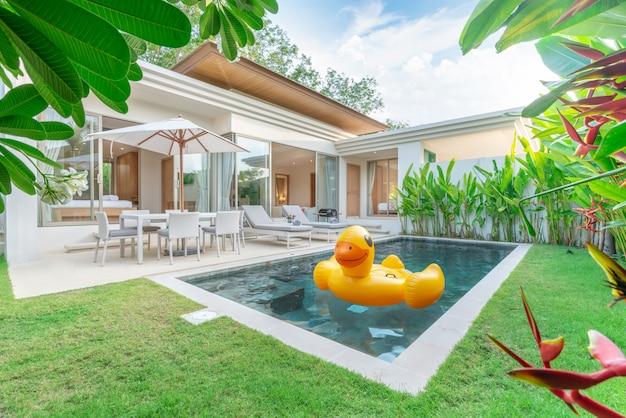 Home  exterior design showing tropical pool villa with greenery garden Premium Photo