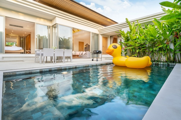 Home exterior design with showing tropical pool villa with greenery garden Premium Photo