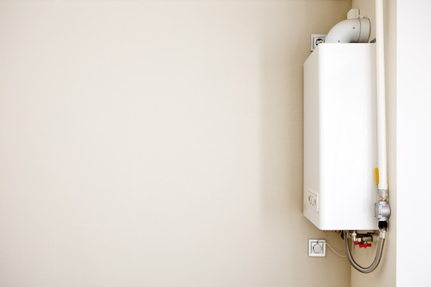 Home gas boiler, water heater. isolated gas stove on a gray background. Premium Photo