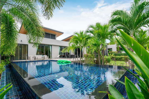 Home or house building exterior and interior design showing tropical pool villa with green garden Premium Photo