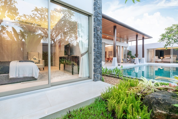 Home or house exterior design showing tropical pool villa with greenery garden and bedroom Premium Photo