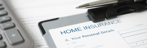 Home insurance documents and ballpoint pen lying on desktop closeup insurance company concept