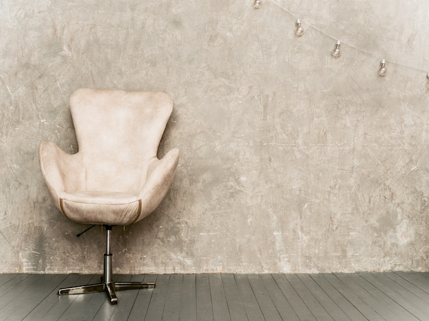 Home interior gray wall background with beige velvet armchair, and wooden floor Free Photo