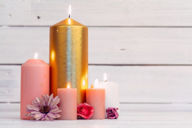 Home lighting candles on wooden table Premium Photo