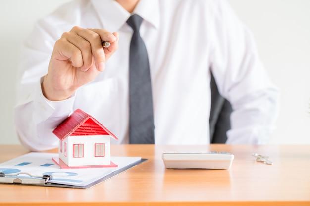 Home salesman stretches holding black pen, Free Photo