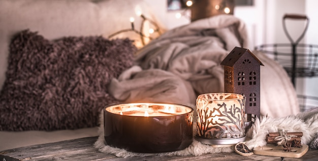 Home still life in the interior with beautiful candles, on the table of a  cozy home decor | Free Photo