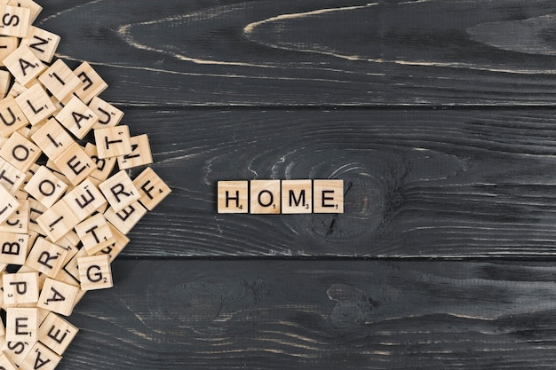 Home word on wooden background Free Photo