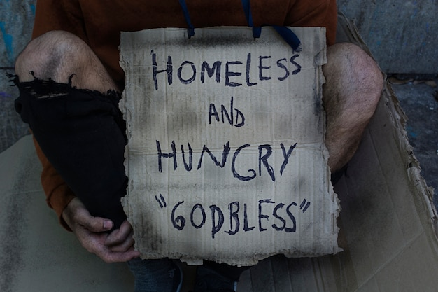 Бездомный и голодный бог благословит знак Бесплатные Фотографии