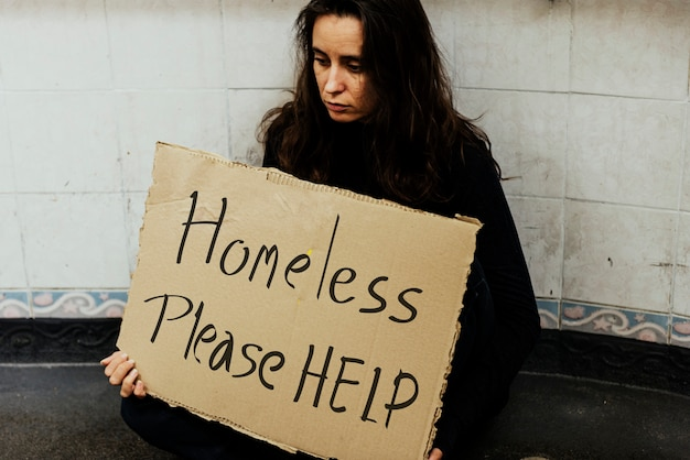 Homeless hungry woman asking for help Premium Photo