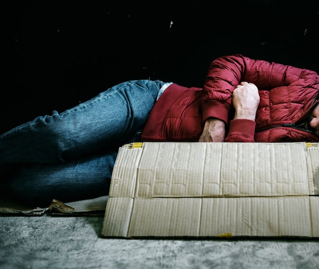 Homeless man sleeping out in the cold Free Photo