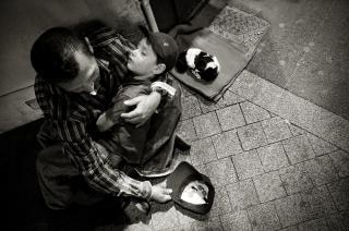 Homeless man with child and puppy Free Photo