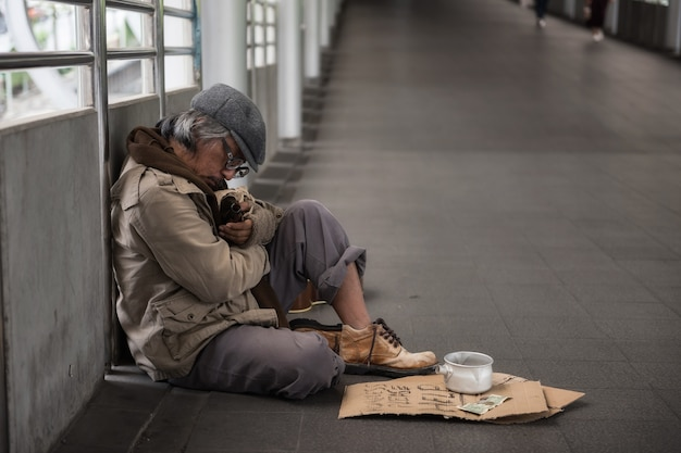 Homeless sleep and hold beer bottle Premium Photo