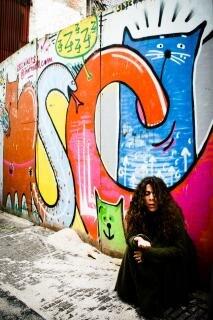 Homeless woman  sitting Free Photo