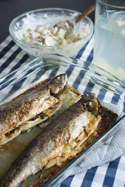 Homemade baked fish with potato salad Free Photo