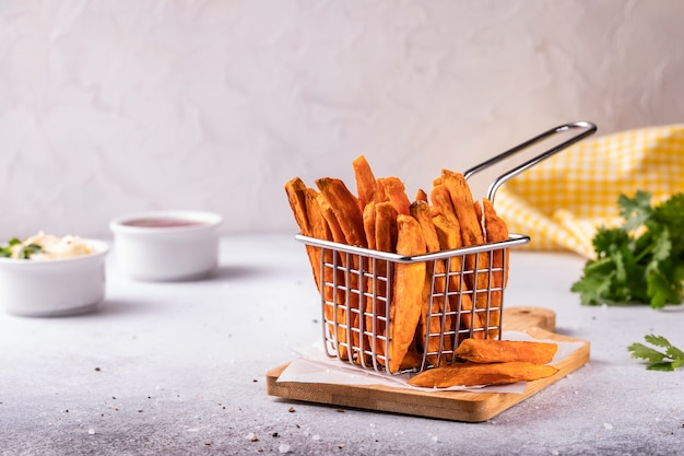 Homemade baked sweet potato french fries with ketchup Premium Photo