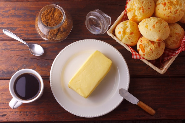 Homemade cheese bread, traditional brazilian snack, on the breakfast table in a rustic farm kitchen Premium Photo