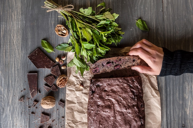 Homemade chocolate brownies on dark surface. Premium Photo
